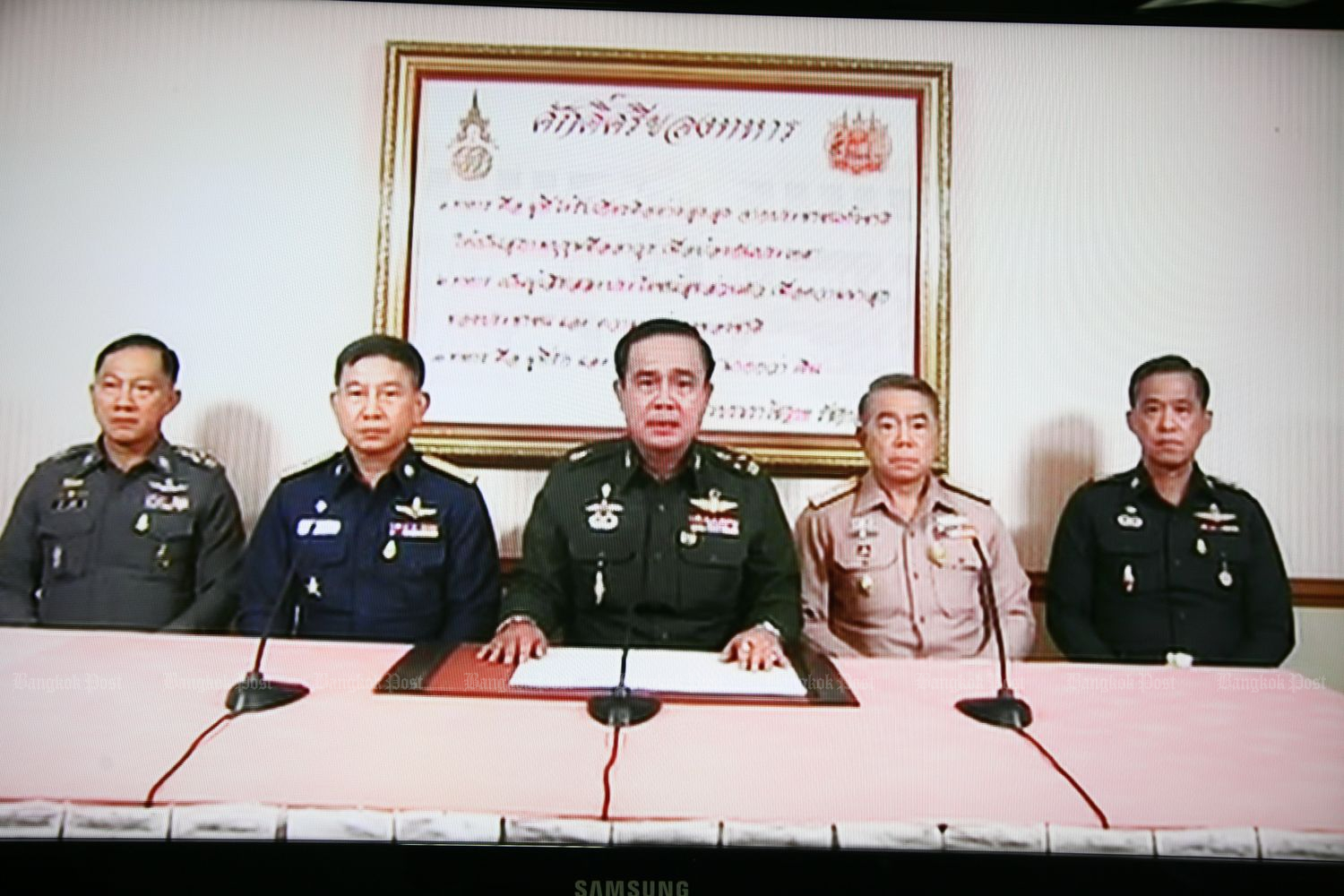 A screenshot from TV footage shows Gen Prayut, together with commanders of the armed forces commanders and the police chief, addressed the people on May 22, 2014 after seizing the ruling power. (Bangkok Post file photo)