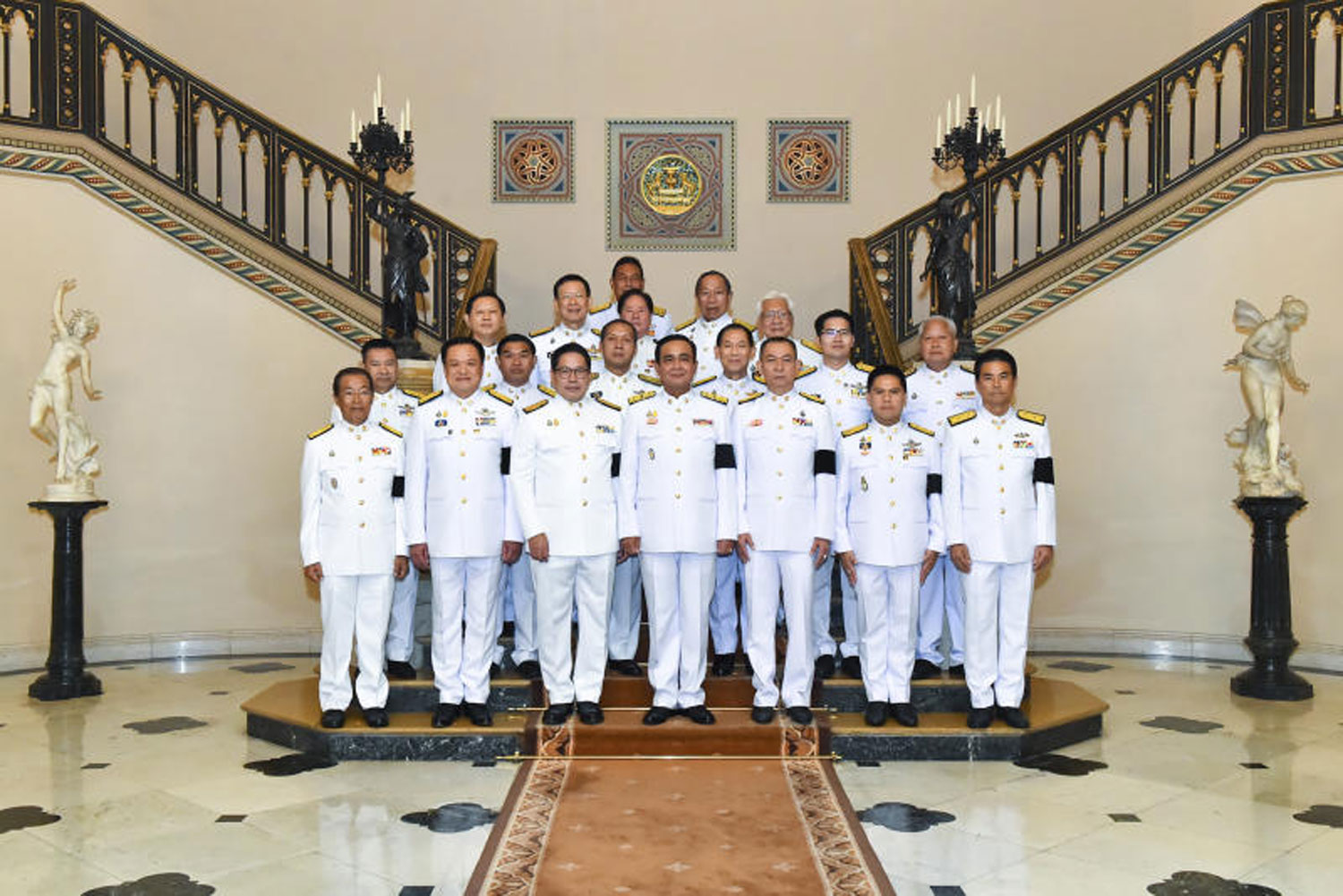 Gen Prayut Chan-o-cha, centre, poses for photos with representatives of coalition parties after receiving a royal command appointing him as the new prime minister at Government House on June 11. His new cabinet ministers were appointed on Wednesday. (Government House photo)