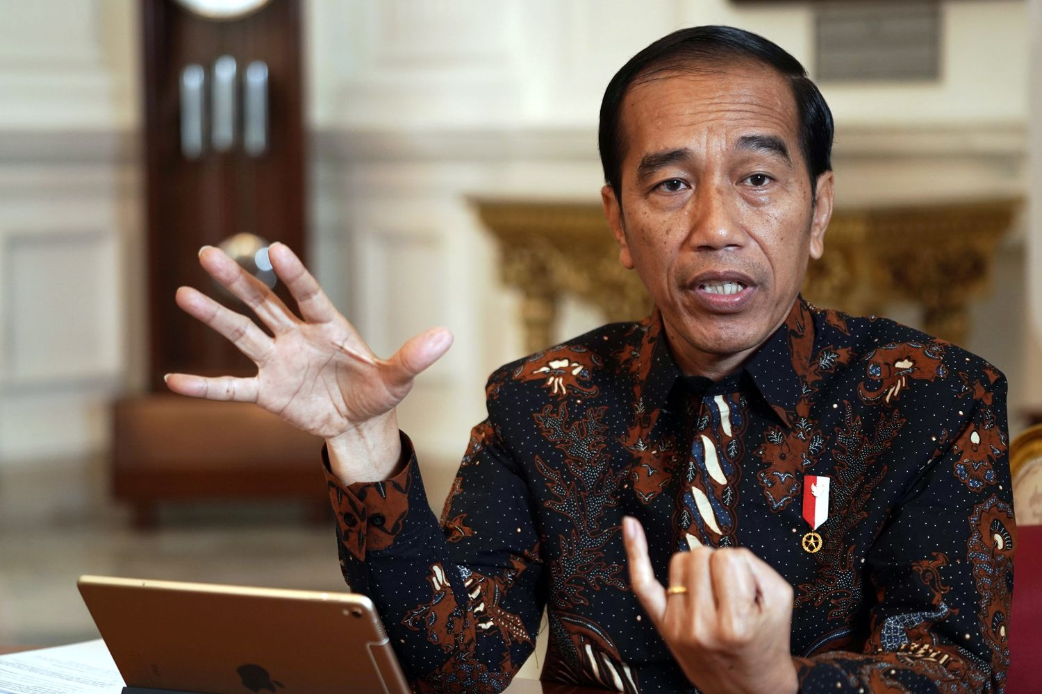 Joko Widodo, Indonesia's president, gestures as he speaks during an interview in Jakarta on Friday. (Blooomberg photo)