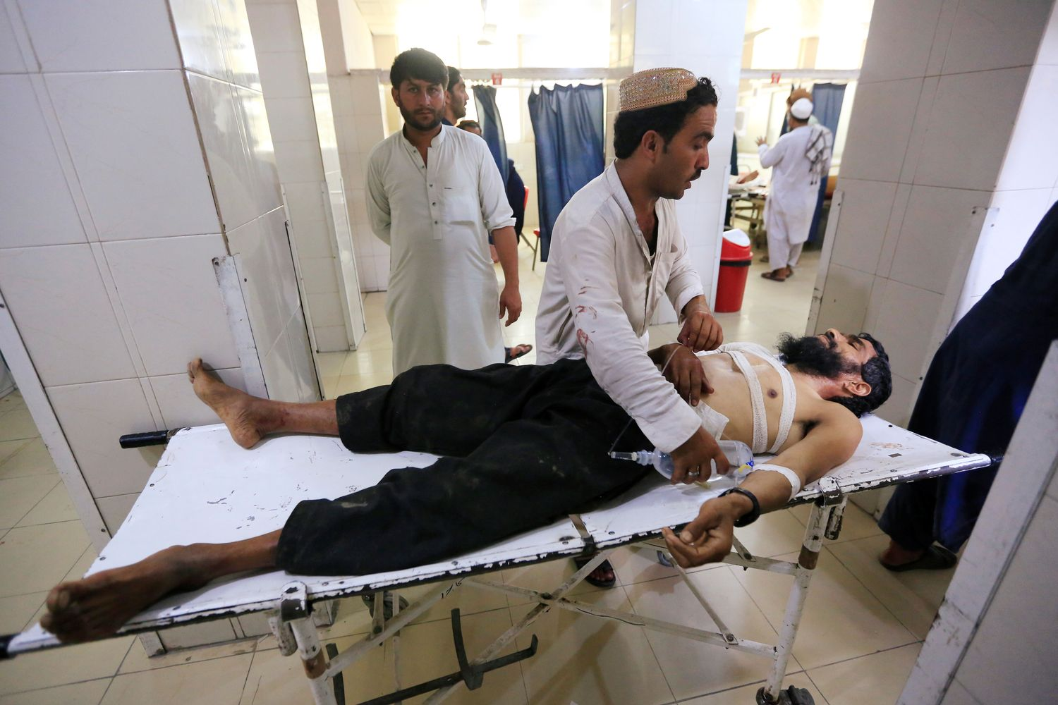 An injured man receives treatment at the hospital, after a suicide attack in Jalalabad, Afghanistan, on Friday. (Reuters photo)