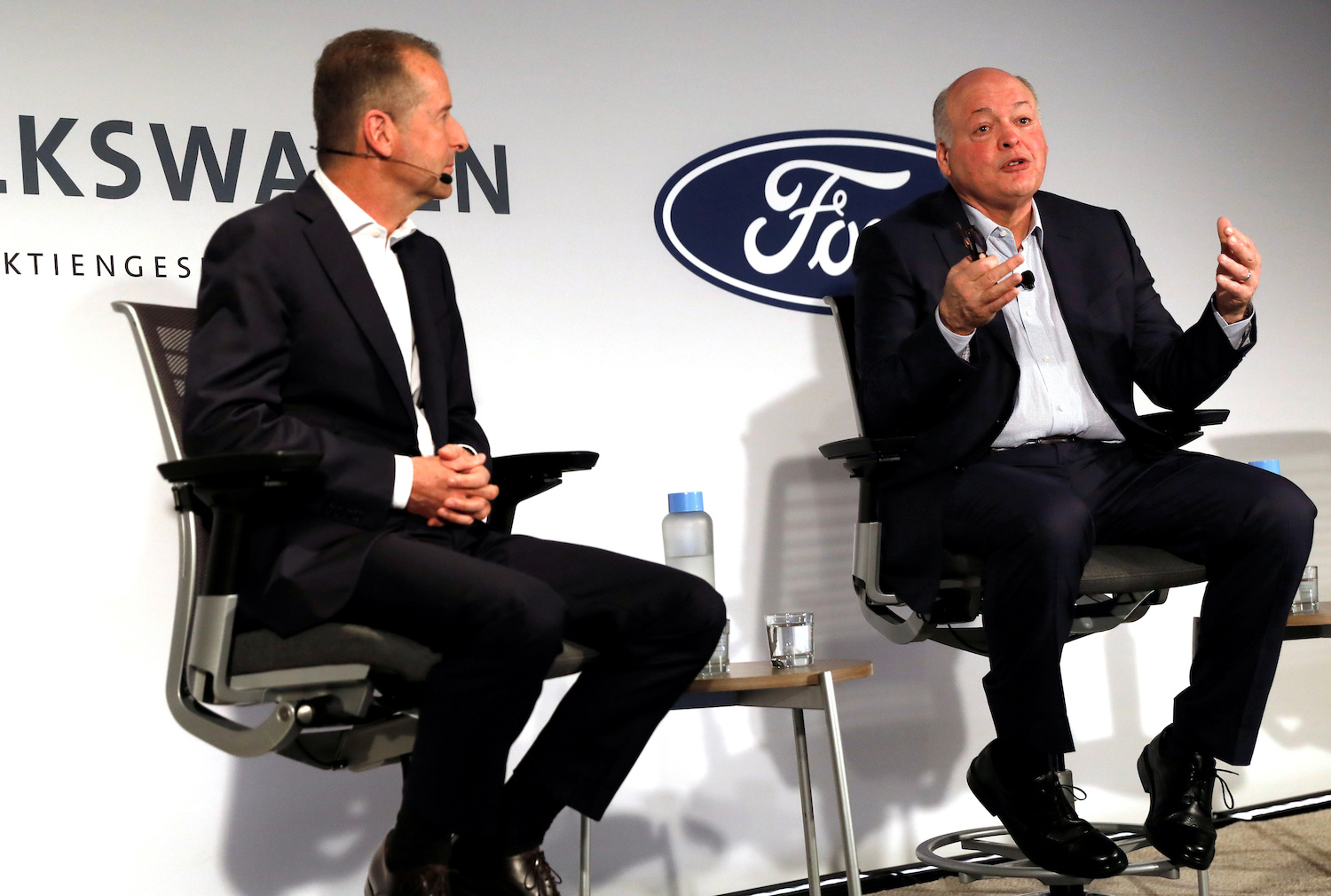Ford president and CEO Jim Hackett speaks as Volkswagen CEO Herbert Diess looks on during a news conference in New York City about the two companies' joint EV and self-driven vehicle plans. (Reuters Photo)