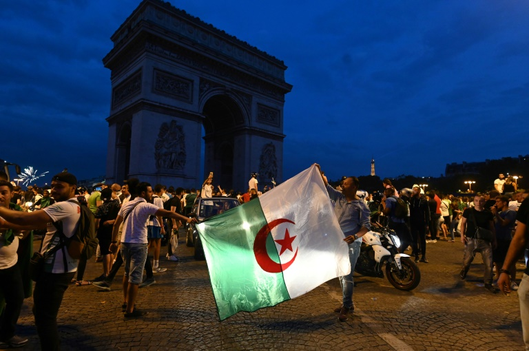 Several thousand people gathered at the Champs-Elysees in the French capital after Algeria's victory against Ivory Coast.