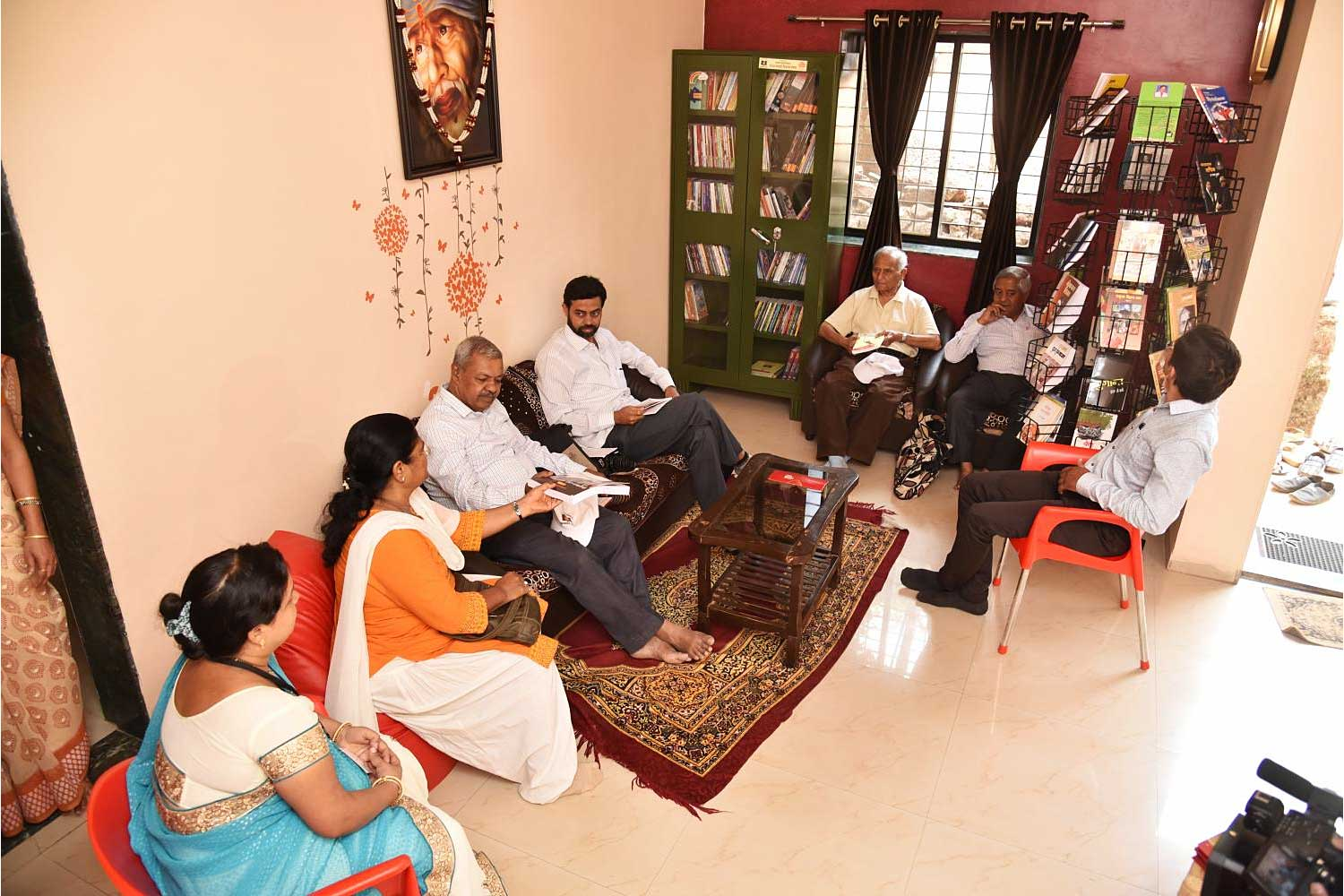 Readers gather in one of the guesthouses devoted to welcoming book lovers in Bhilar in Maharashtra state.