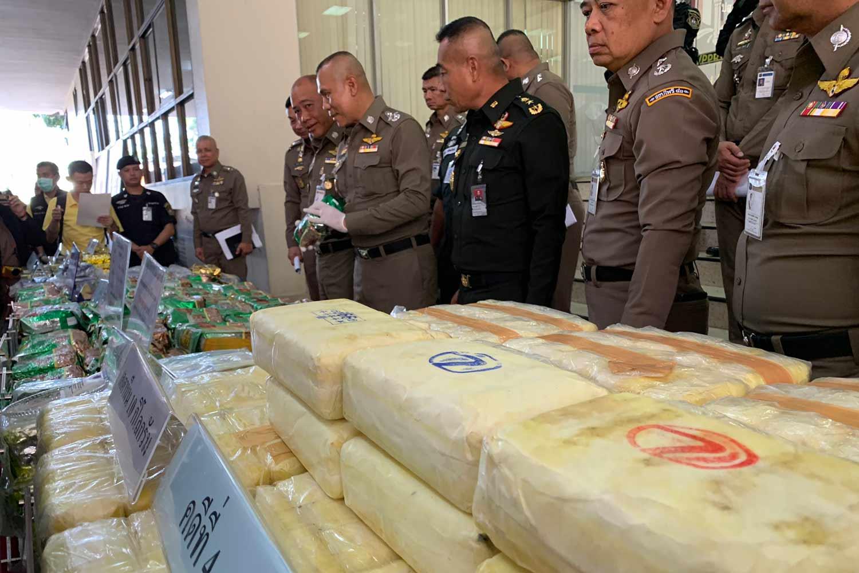 Senior police, including deputy national police chief Pol Gen Chalermkiat Srivorakhan, display seized illicit drugs at the Narcotics Suppression Bureau in Bangkok on Monday. (Photo supplied)