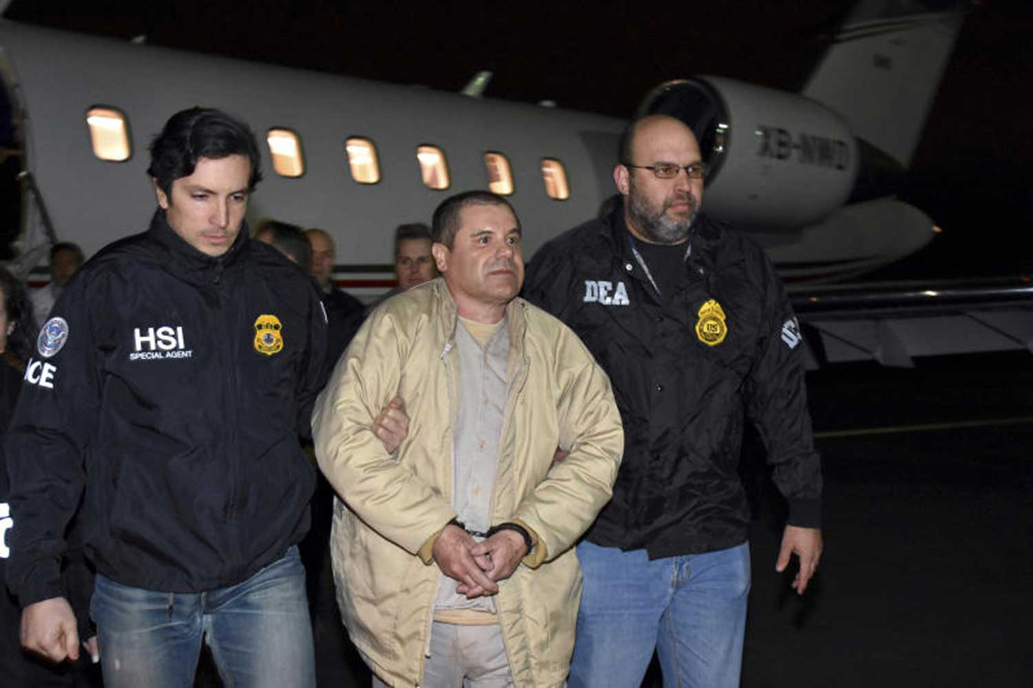 FILE - In this Jan 19, 2017, file photo provided by US law enforcement, authorities escort Joaquin