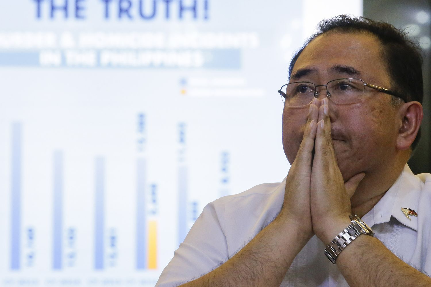 Undersecretary Severo Catura, executive director of the Presidential Human Rights Committee secretariat, gestures as he listens to questions from reporters during a news conference in metropolitan Manila, Philippines, on Thursday. (AP photo)
