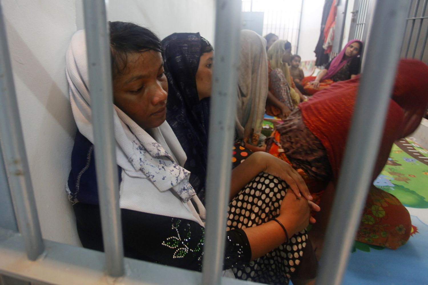 In this June 12, 2019 file photo, Rohingya refugees sit behind bars at a police station in Satun province after Thai officials say they have discovered 65 ethnic Rohingya Muslim refugees who were shipwrecked and stranded in southern Thailand. (AP photo)