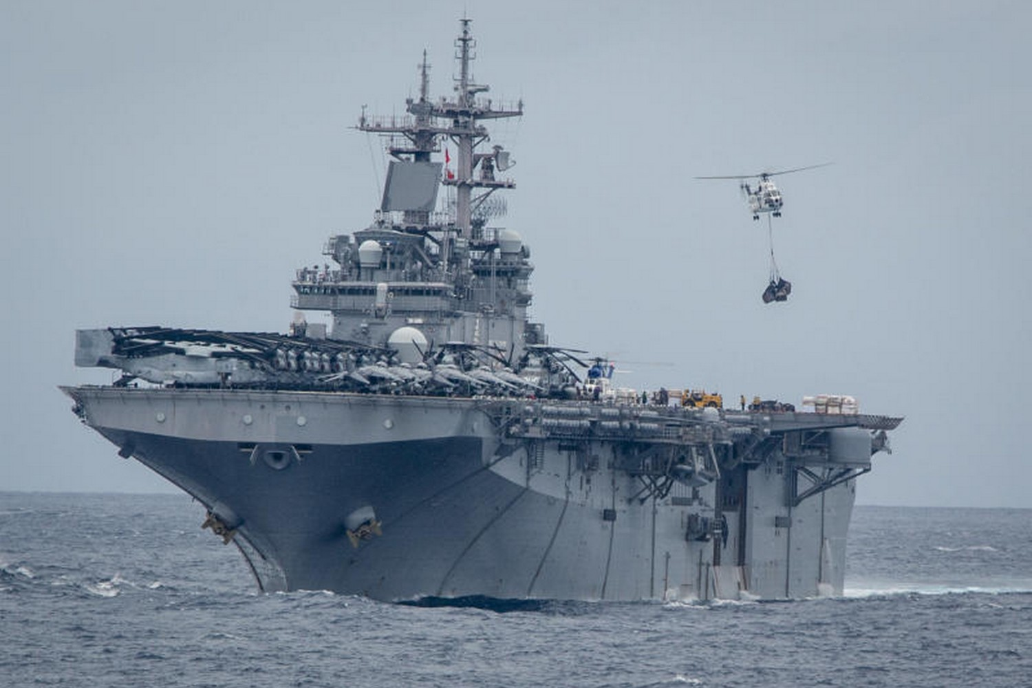 A helicopter delivers supplies to the USS Boxer, an amphibious assault ship, in the Andaman Sea, on June 8, 2019. The US announced the ship downed an Iranian drone near the Strait of Hormuz on Thursday. (Photo: US  Marine Corps via NYT)