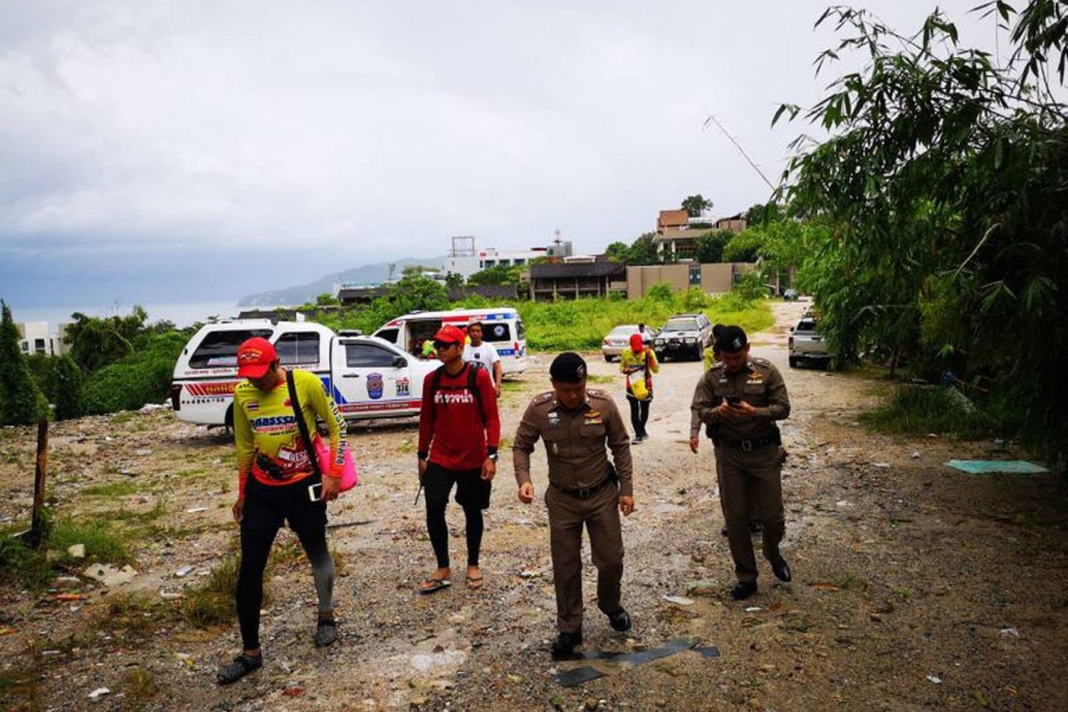 Police and workers check the area for two missing Philippine tourists at Freedom Beach, Phuket, on Friday. A body believed to be one of them was found in the area. (Photo supplied by Achadtaya Chuennirun)