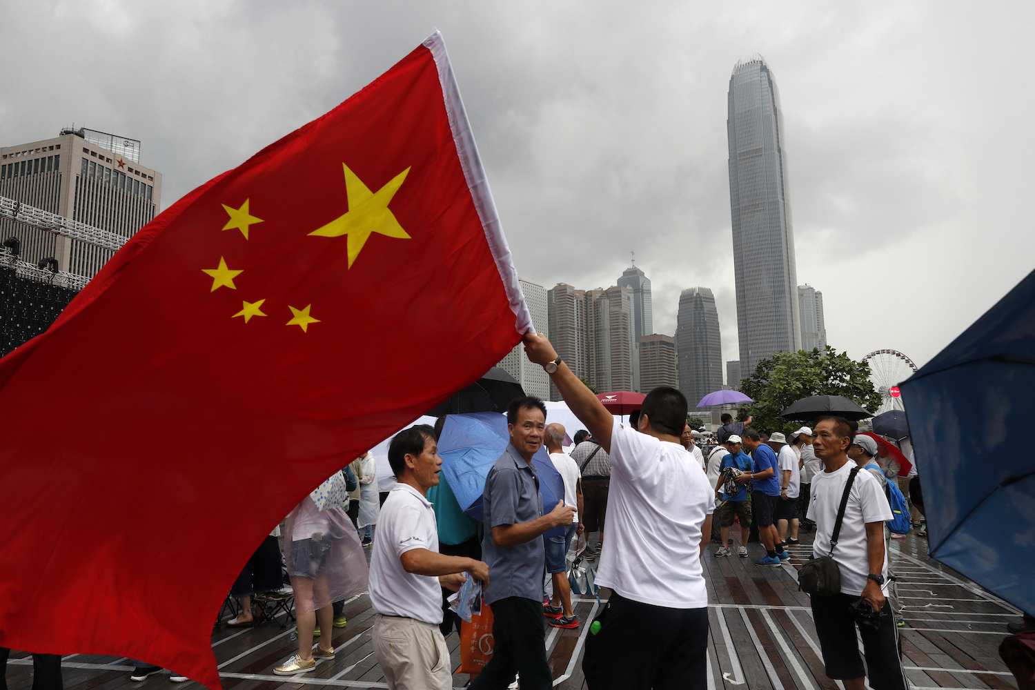 A pro-China supporter waves a Chinese national flag during a counter-rally in support of the police in Hong Kong on Saturday. (AP Photo)