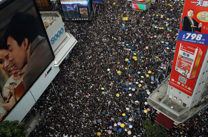 Hong Kong locks down as thousands gather for latest rally