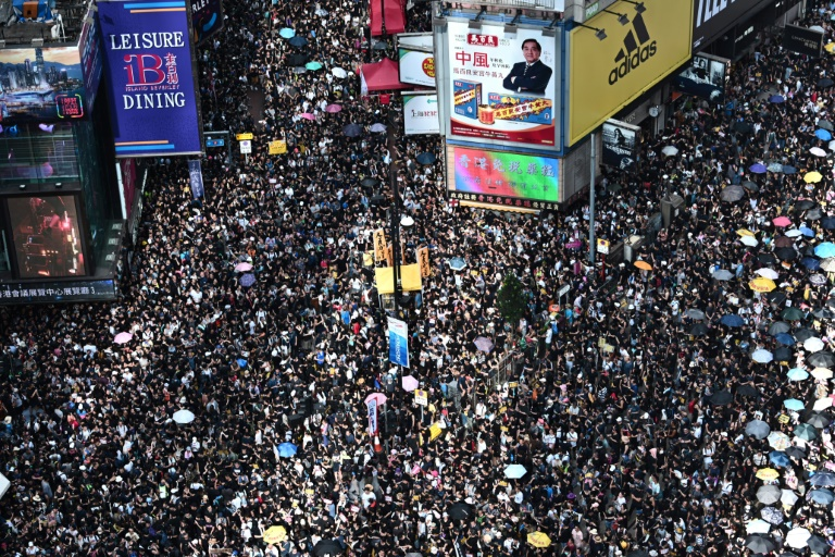 Hong Kong protesters egg China office at end of massive rally