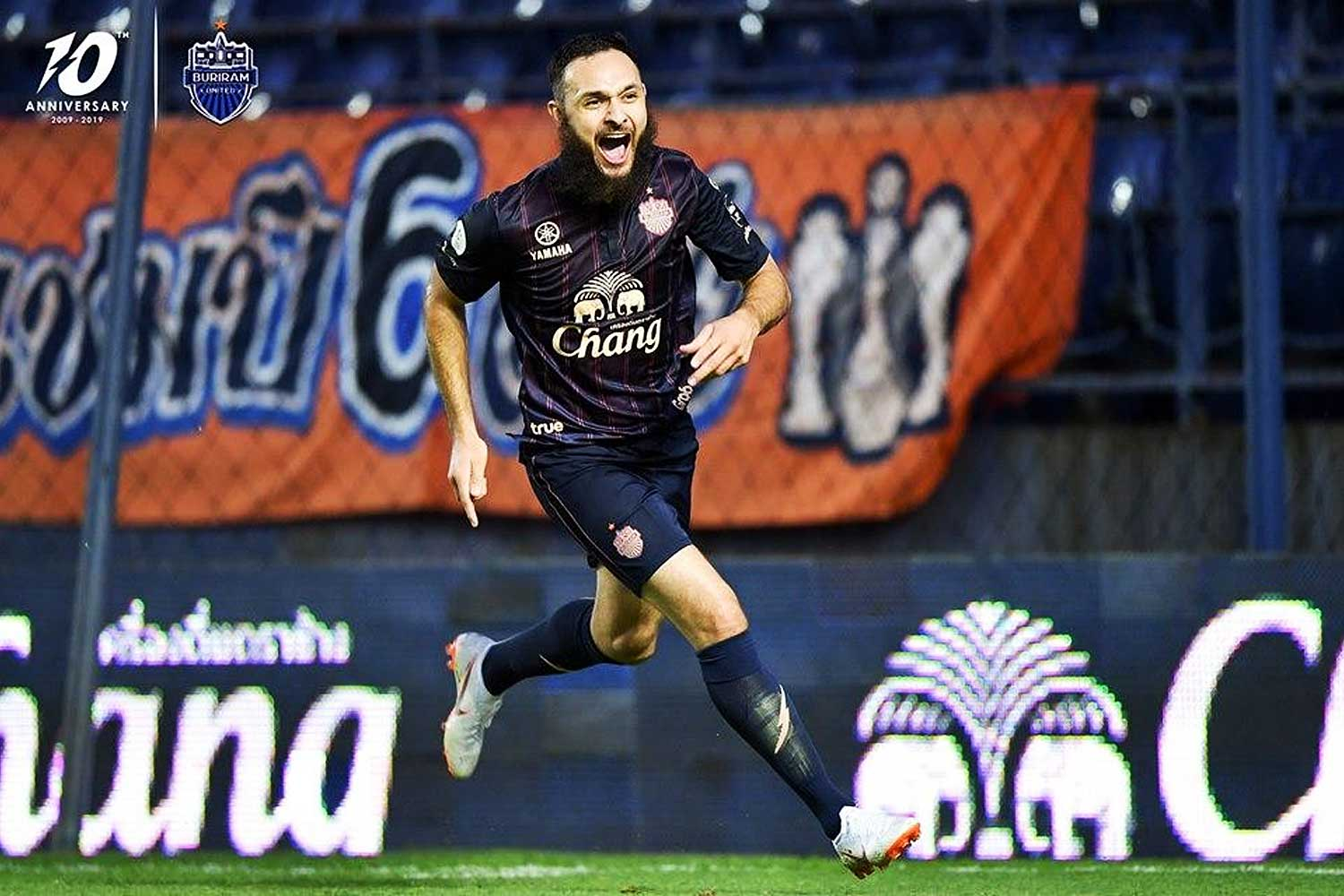 Buriram United striker Nacer Barazite celebrates his goal against Bangkok United.