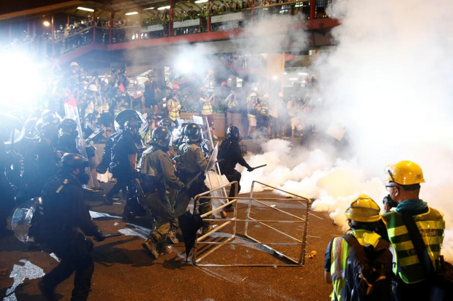 Riot police clash with anti-extradition demonstrators on Sunday night after a march to call for democratic reforms in Hong Kong. (Photo: Reuters)