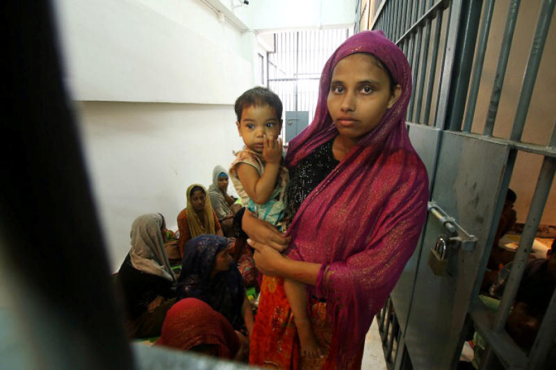 A Rohingya woman and her baby are seen detained in a police station after a fishing boat carrying more than sixty Rohingya refugees was found beached at Rawi island, part of Tarutao national park in the province of Satun, Thailand, bordering with Malaysia, June 12, 2019. (Reuters file photo)
