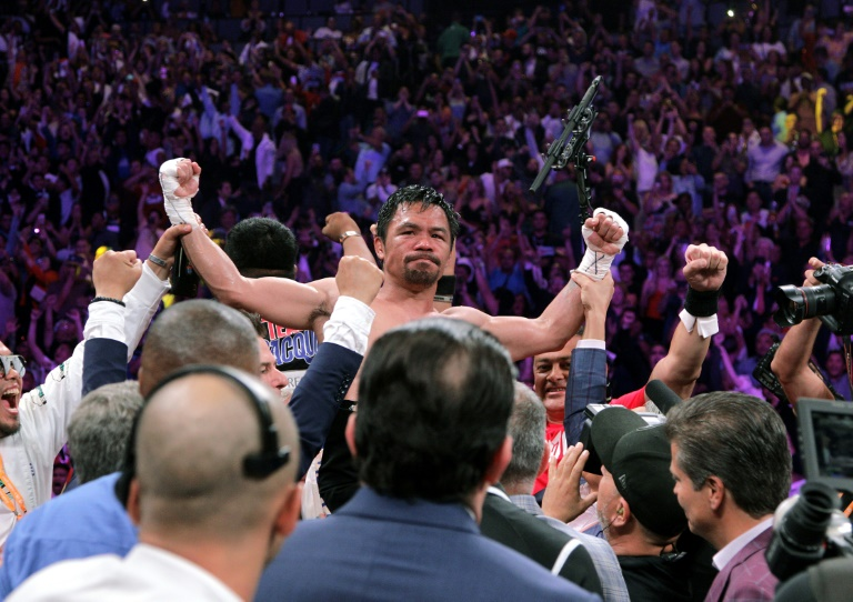 Filipino boxer Manny Pacquiao celebrates after beating US boxer Keith Thurman during their WBA super world welterweight title fight.