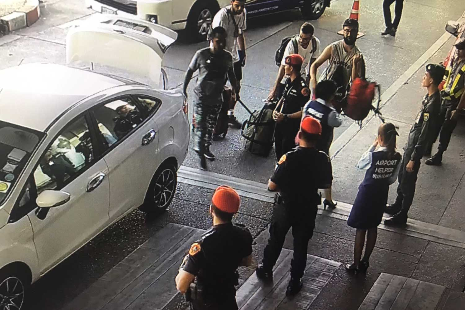 CONFRONTATION: Grab car driver Suchart Chaipraya, at the back of his car, is stopped at Gate 5 of Chiang Mai airport on July 20. He has accused airport security officials of assaulting him, which they deny. (Supplied photo)