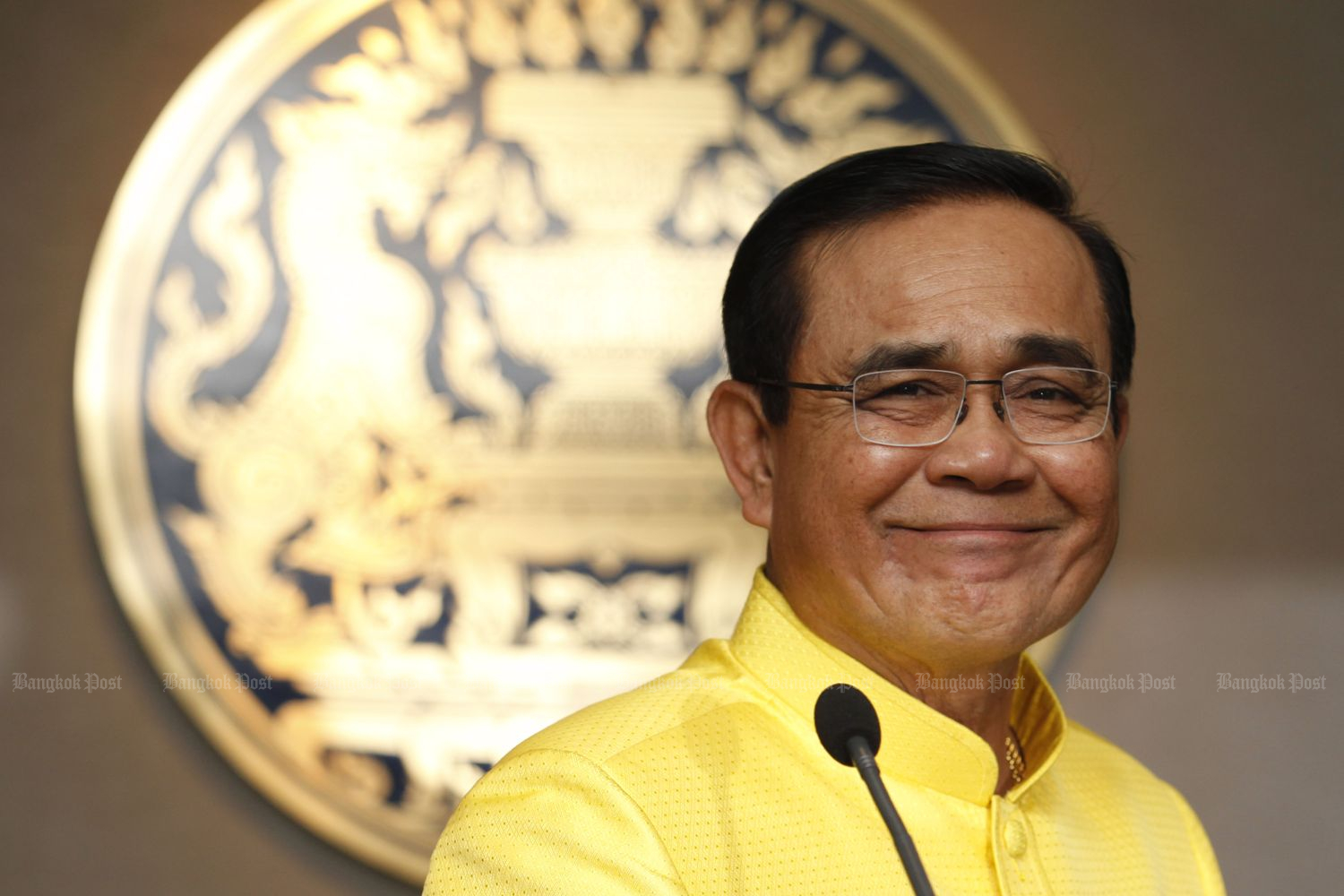 Prime Minister Prayut Chan-o-cha smiles during a briefing after the first cabinet meeting of his government on Tuesday. (Photo by Wichan Charoenkiatpakul)