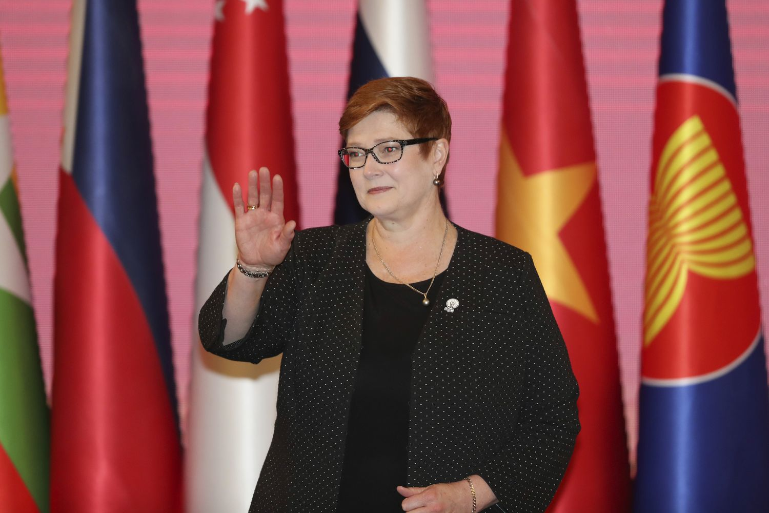 Australian Foreign Minister Marise Payne waves during a group photo with Asean foreign ministers at a meeting in Bangkok on Thursday. (AP photo)