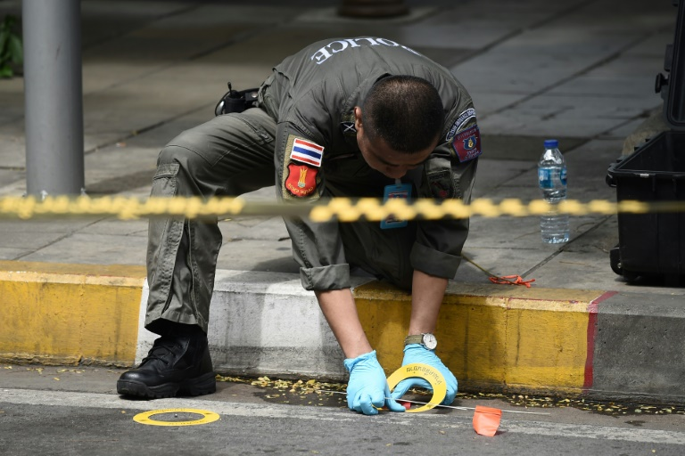 A policeman at the scene of one of the explosions