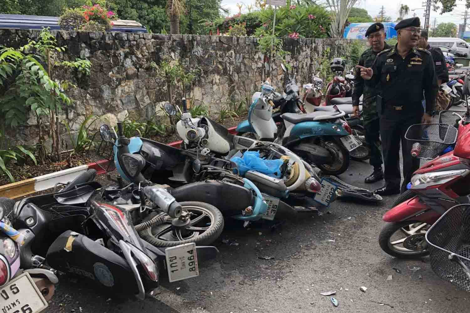 Security officers examine three damaged motorcycles parked at the Hua Hin train station in Prachuap Khiri Khan province on Sunday. A bomb squad shot high-speed jets of water at the bikes, suspecting they contained bombs. (Photo by Chaiwat Satyaem)