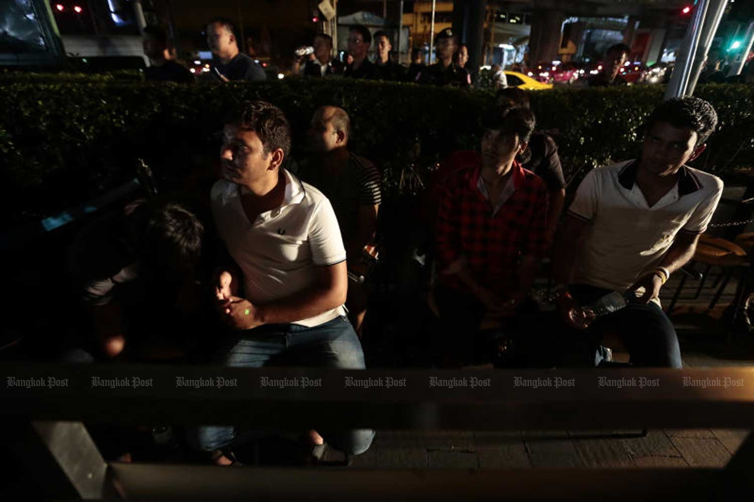 Foreign nationals are rounded up in police raids in Bangkok last year. Many were charged with overstaying their visas. (File photo by Patipat Janthong)