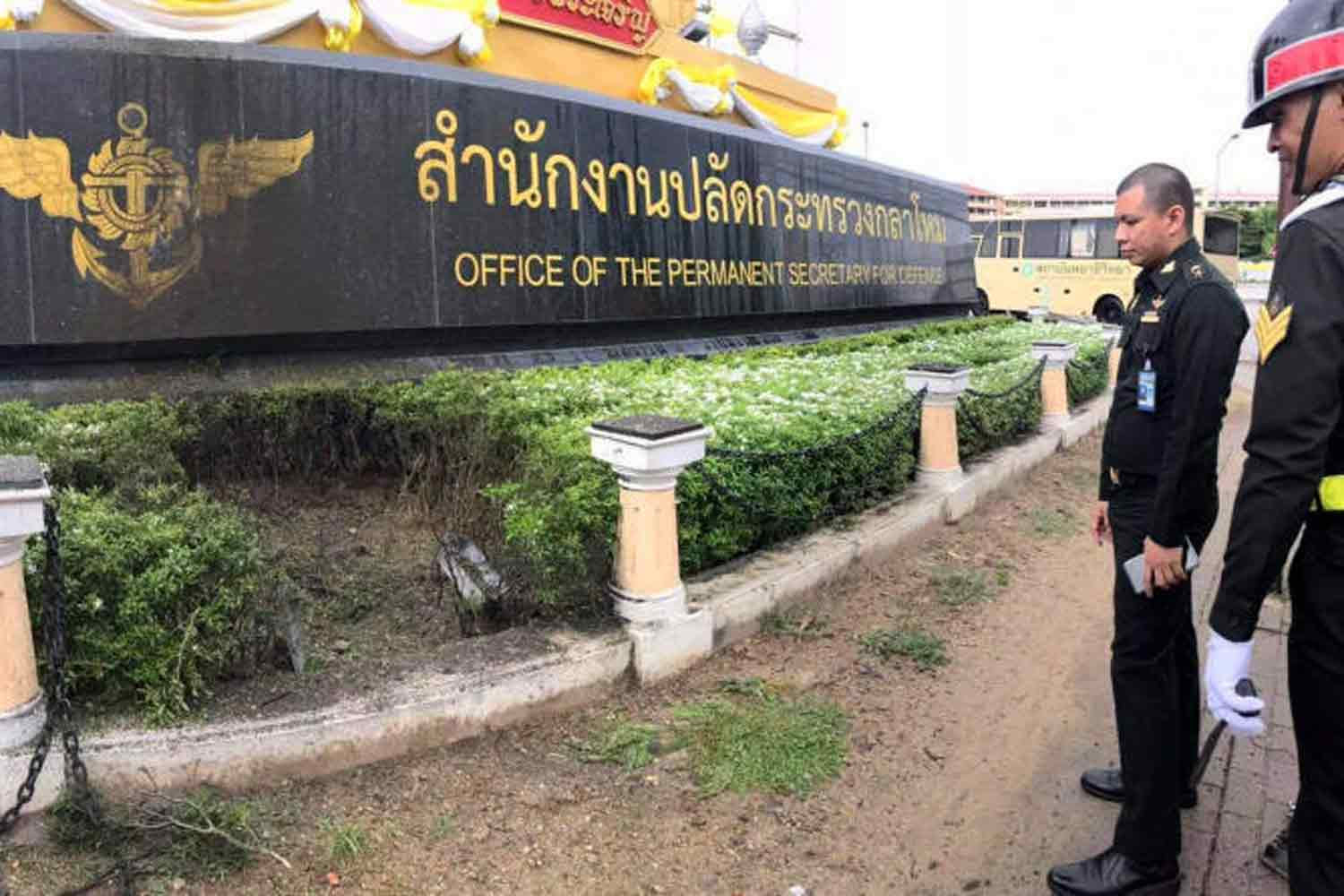 Officers inspect a blast site in front of the Office of the Permanent Secretary for Defence in Don Muang district, Bangkok, last Friday. (Photo supplied)