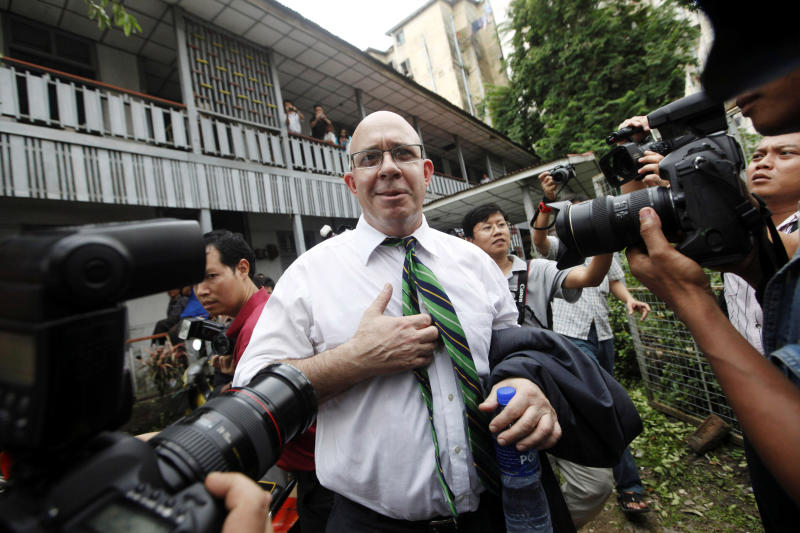 FILE PHOTO: Australian journalist Ross Dunkley talks to reporters after his court hearing at Kamaryut township in Yangon June 30, 2011. (Reuters)