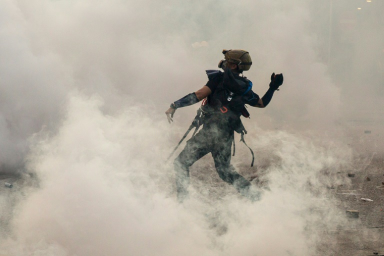 Police have ramped up their use of tear gas as two months of rallies in the global financial hub have turned increasingly violent.