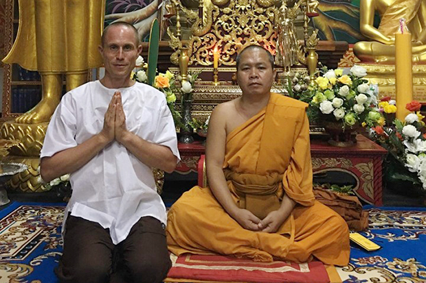 Former Phra Julien offers a wai for people to forgive him after he left the monkhood on Saturday. (Photo from @phrajuliensfoundation Facebook account)