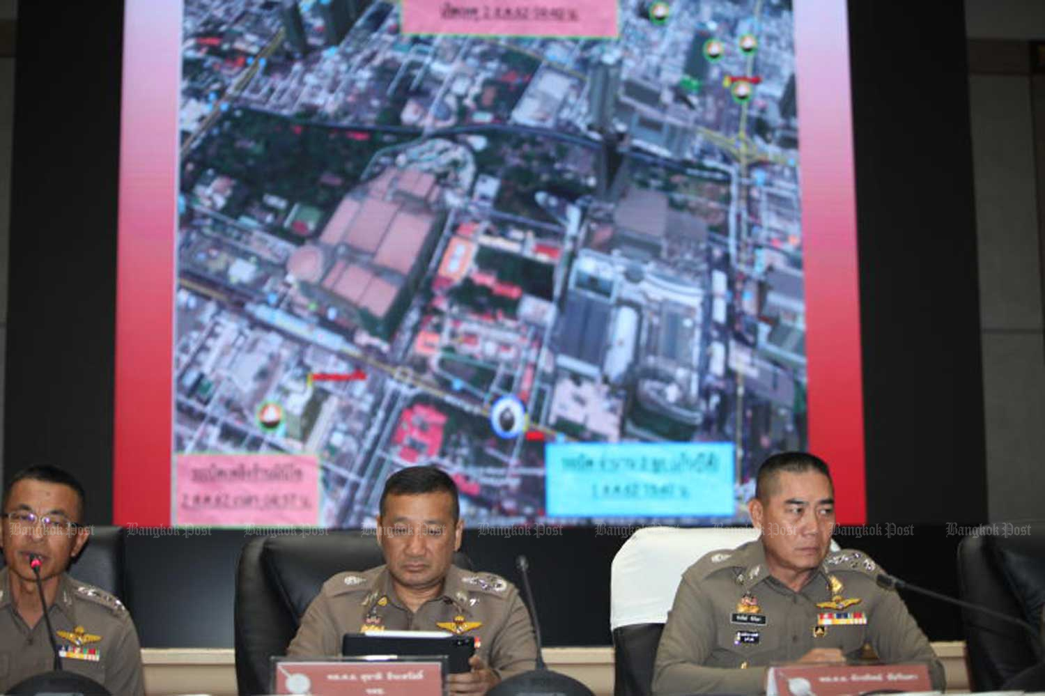 A poster featuring photos and details of suspects in bombing attacks in Bangkok and Nonthaburi early this month is seen at a press conference called last Thursday to present the police's findings in the case to the public. (Photo by Apichart Jinakul)