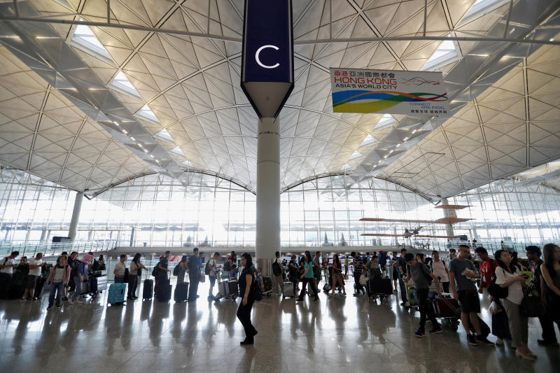 Hong Kong's airport reopens after protests but more than 200 flights cancelled