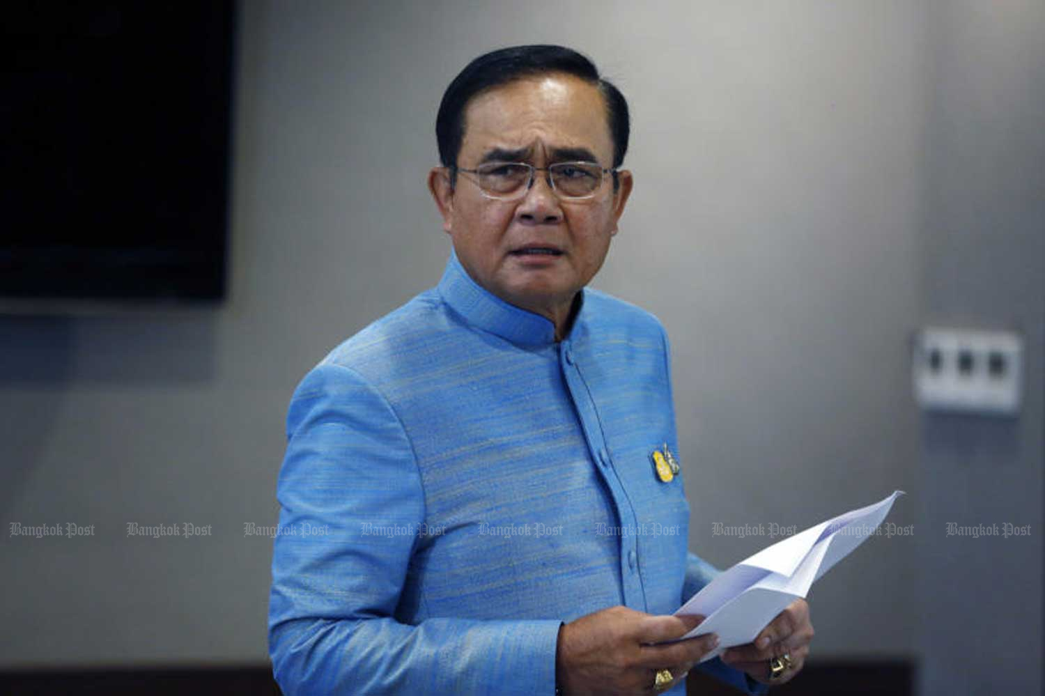 Prime Minister Prayut Chan-o-cha speaks to reporters after a cabinet meeting at Government House in Bangkok on Tuesday. (Photo by Pornprom Satrabhaya)