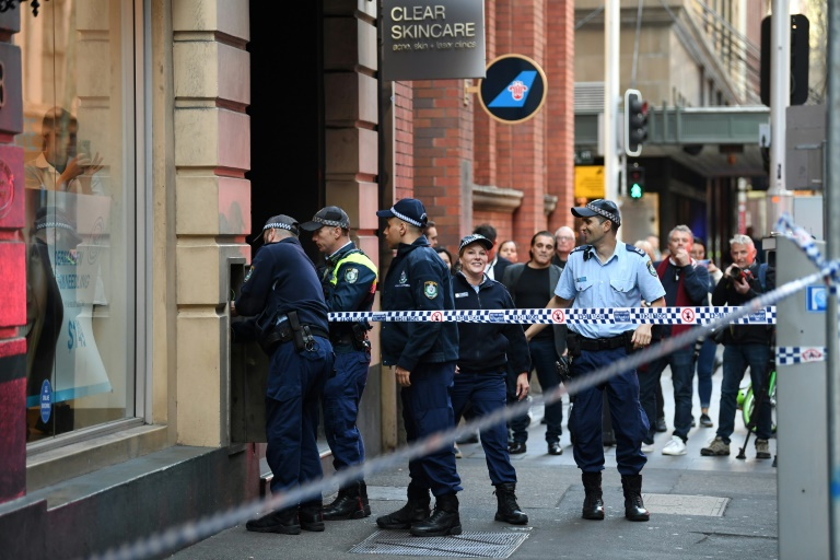 Police investigate the area where a man went on a stabbing rampage in Sydney.