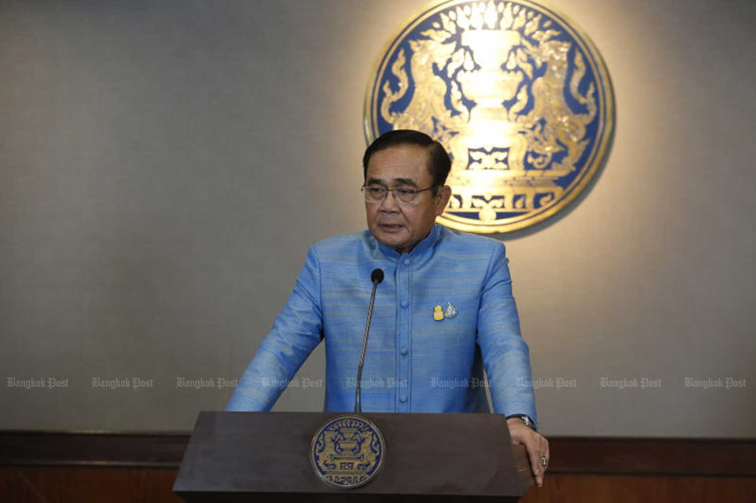 Prime Minister Prayut Chan-o-cha speaks to reporters after the cabinet's meeting at Government House in Bangkok on Tuesday. (Photo by Pornprom Satrabhaya)