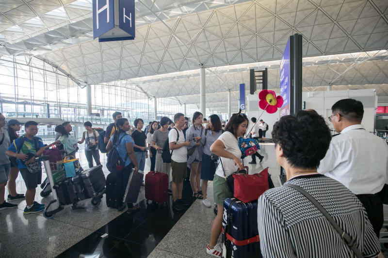 Travellers queue in the departure hall at Hong Kong international airport on Wednesday. (Bloomberg photo)