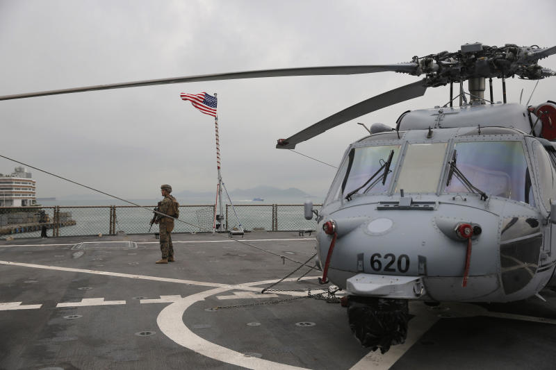 In this April 20, 2019, file photo, a US marine patrols on the deck of the USS Blue Ridge, flagship of the US Seventh Fleet, during a port call in Hong Kong, April 20, 2019. (AP)