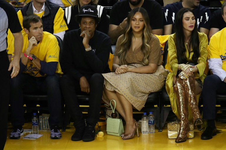 The Roc Nation entertainment company of rap star Jay-Z (left center beside Beyonce) has entered into a partnership with the NFL.