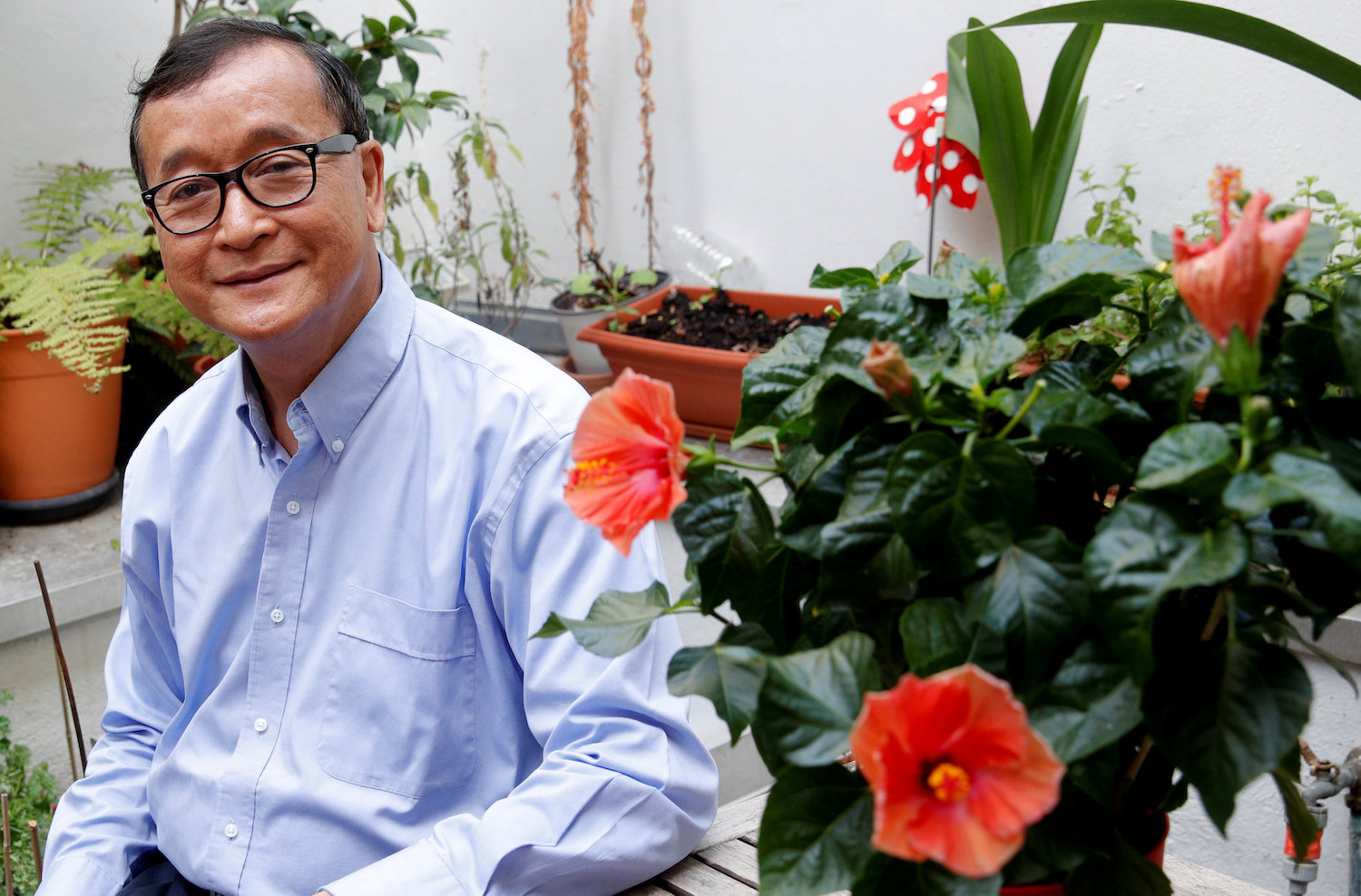 Sam Rainsy, who is living in exile, is photographed on his terrace in Paris in July 2018. (Reuters Photo)