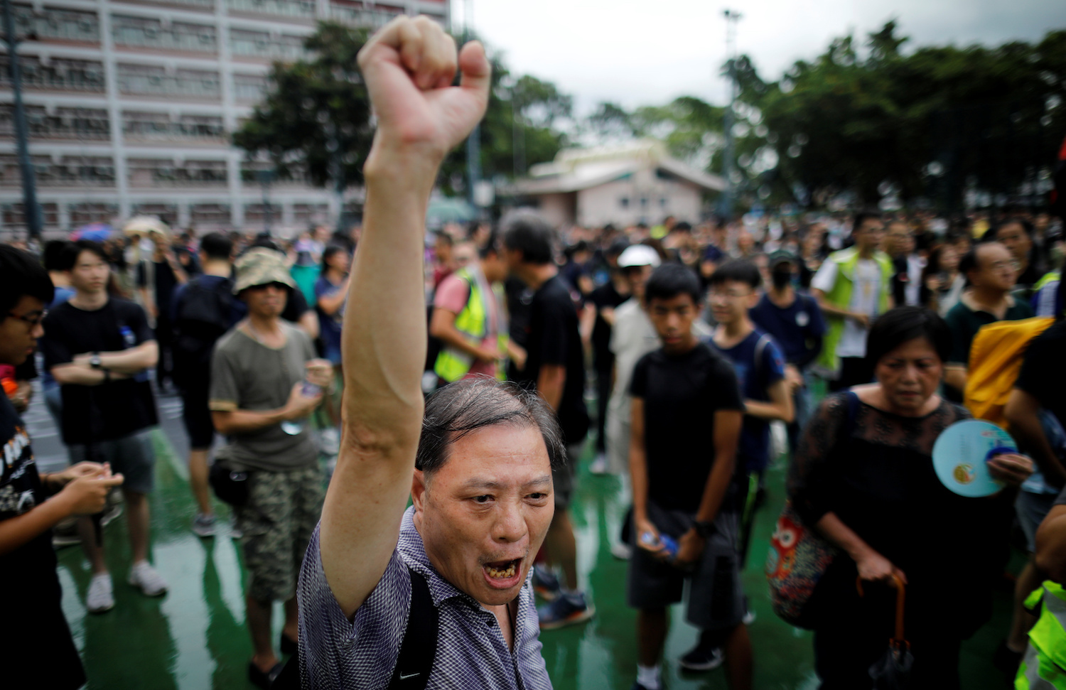 A man gestures during a demonstration against the Hong Kong administration in the To Kwa Wan neighbourhood on Saturday. (Reuters Photo)