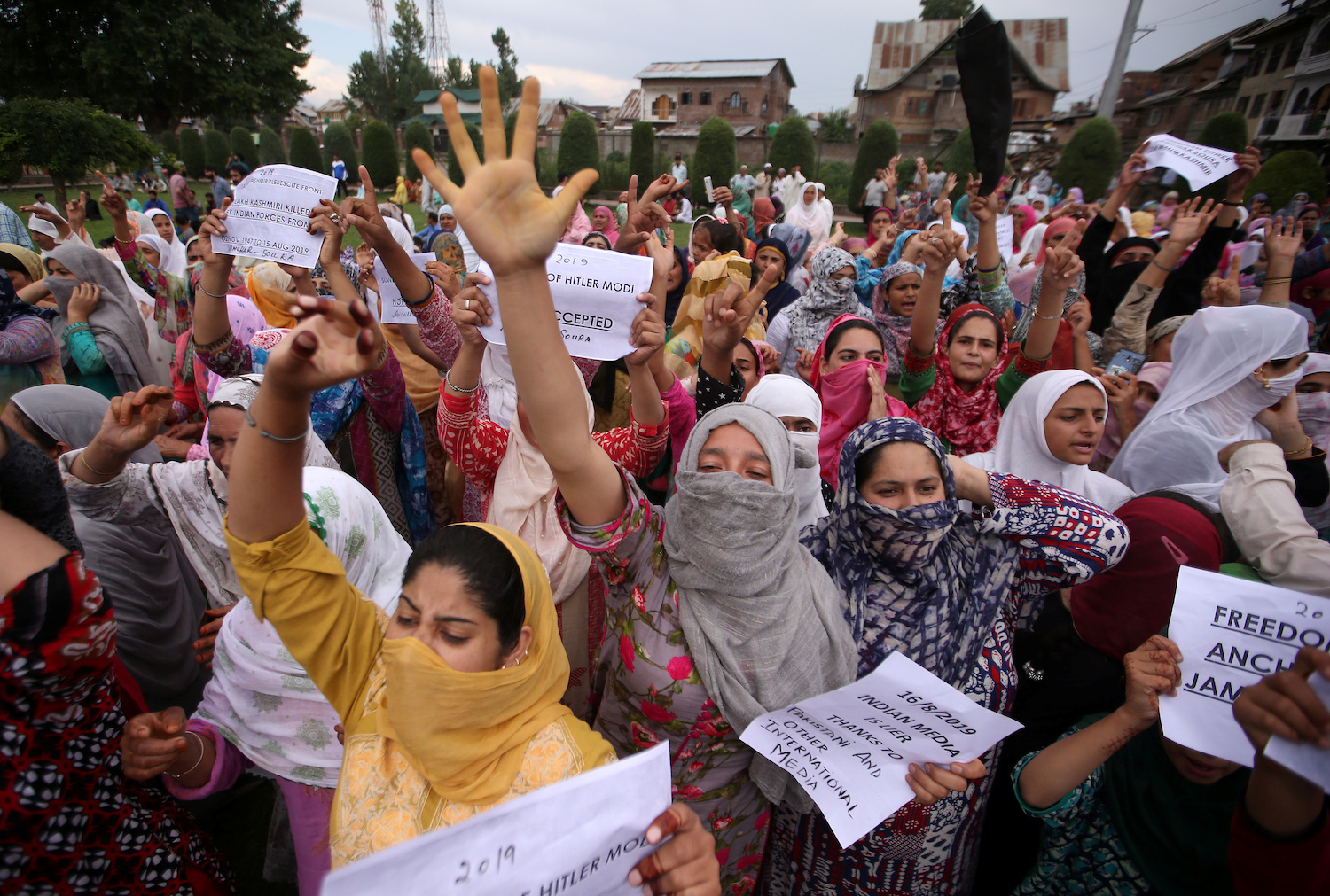 Kashmiri women shout slogans at a protest after Friday prayers in Srinagar about the restrictions imposed on the area by the Indian government. (Reuters Photo)