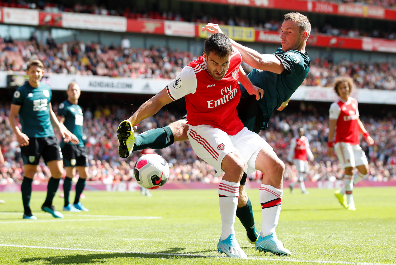 Burnley's Chris Wood pursues Arsenal's Sokratis Papastathopoulos during the clubs' Premier League match at Emirates Stadium on Saturday. (Reuters Photo)