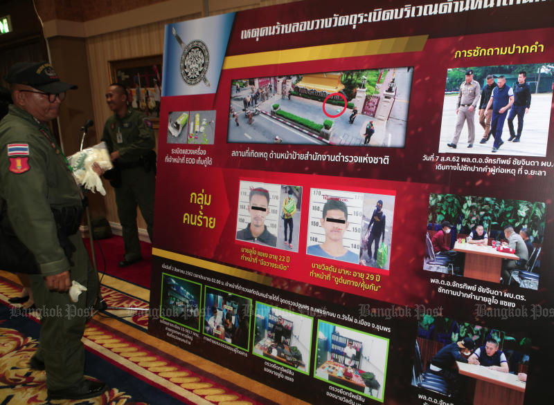 A poster featuring photos and details of suspects in recent bombing attacks in Bangkok and Nonthaburi is seen at a police press conference on Aug 7. (Photo by Apichart Jinakul)