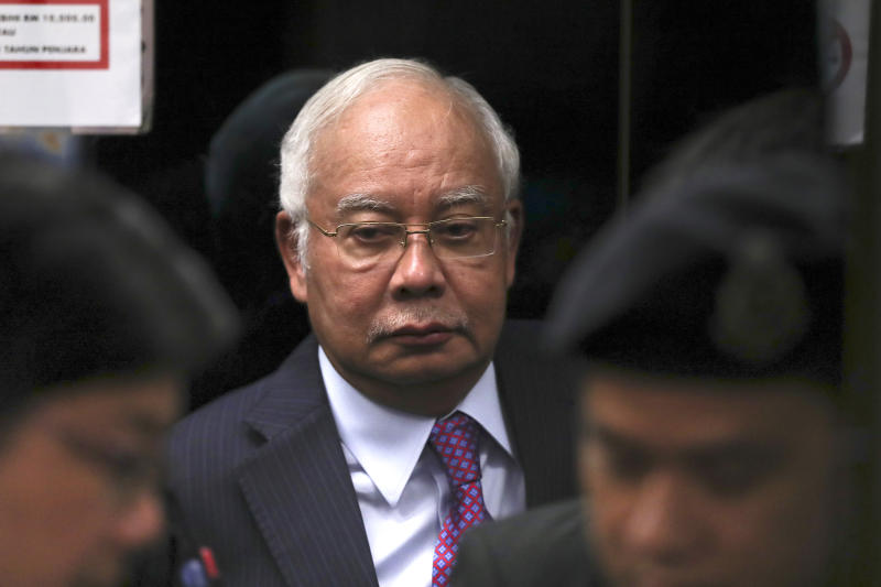 In this June 18, 2019, file photo, former Malaysian Prime Minister Najib Razak walks into a lift as he arrives at Kuala Lumpur High Court in Kuala Lumpur, Malaysia. (AP)