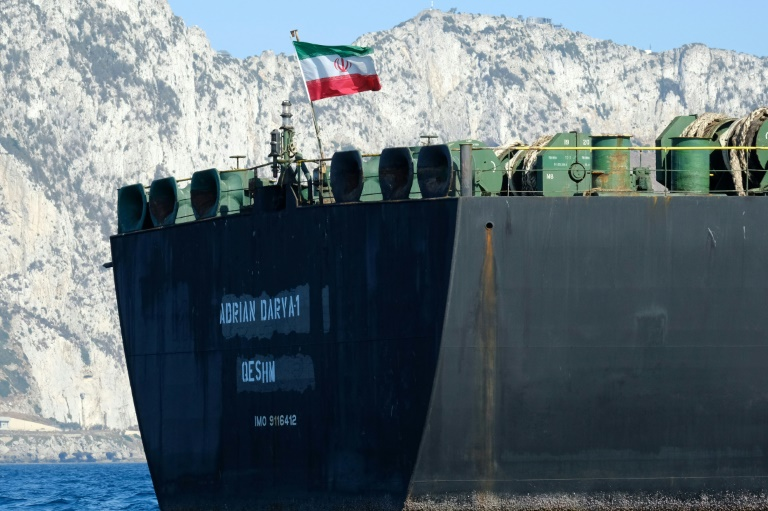 An Iranian flag flutters on board the Adrian Darya oil tanker, formerly known as Grace 1, off the coast of Gibraltar on August 18, before it set sail.