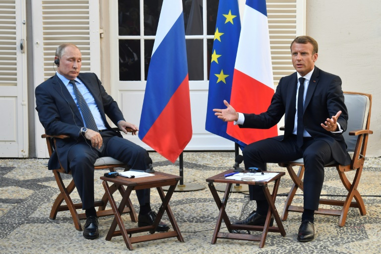 Putin, Macron agree on chances of Ukraine talks but differ on Syria