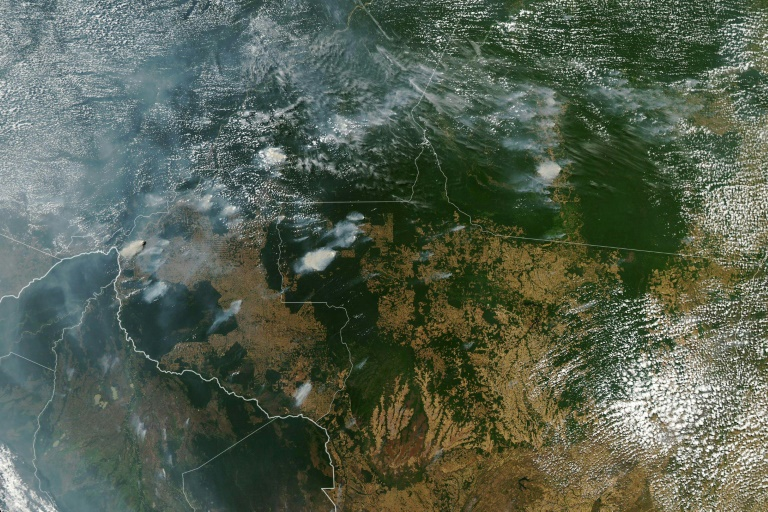 A NASA Earth Observatory image shows several fires burning in the Brazilian states of Amazonas (top left), Para (top right), Mato Grosso (bottom right) and Rondonia (bottom centre) on Aug 11, 2019, while Bolivia appears bottom left.