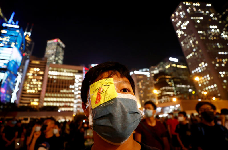 A protester wears an eyepatch with a slogan as students attend a rally to call for political reforms outside City Hall in Hong Kong on Thursday. (Reuters photo)