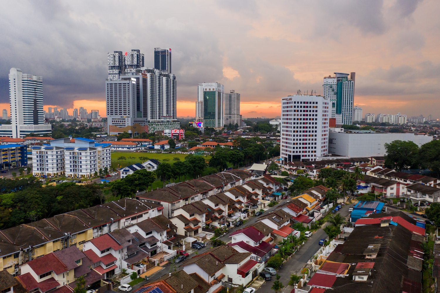 The sun sets beyond residential and commercial buildings in Johor Bahru, Malaysia. (Bloomberg Photo)