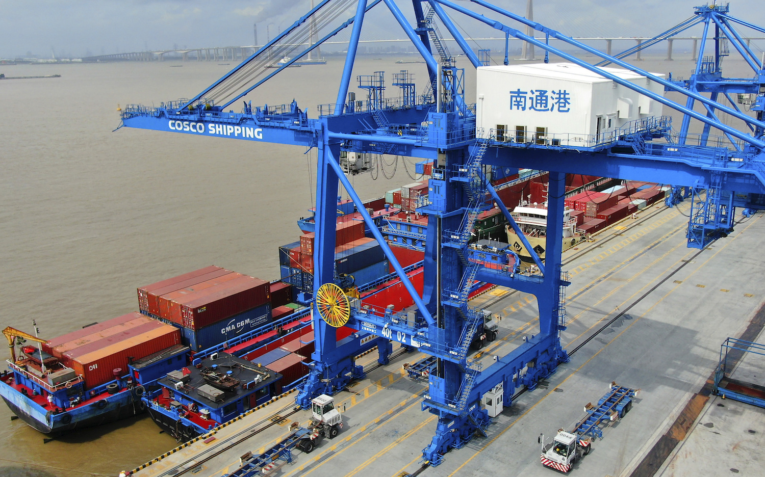 Shipping containers are loaded onto a cargo ship at a port in Nantong in eastern China. (AP photo)